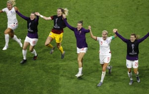 Steph Houghton (second right) and teammates celebrate with the England fans.