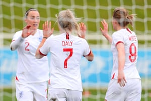Rachel Daly celebrates with teammates Lucy Bronze and Ellen White after scoring.