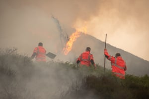 Firefighters work to control the fires on Saddleworth Moor