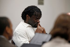 Death row inmate Marcus Robinson listens in court.