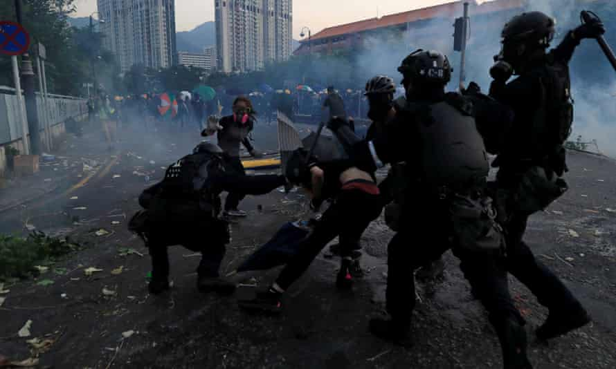 Riot police clash with protesters in the Sha Tin district of Hong Kong.