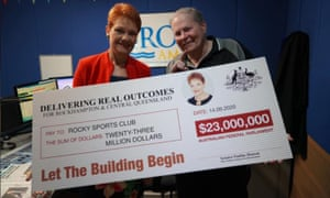 One Nation leader Pauline Hanson (left) poses with a $23m novelty cheque to Rocky Sports Club on Monday.