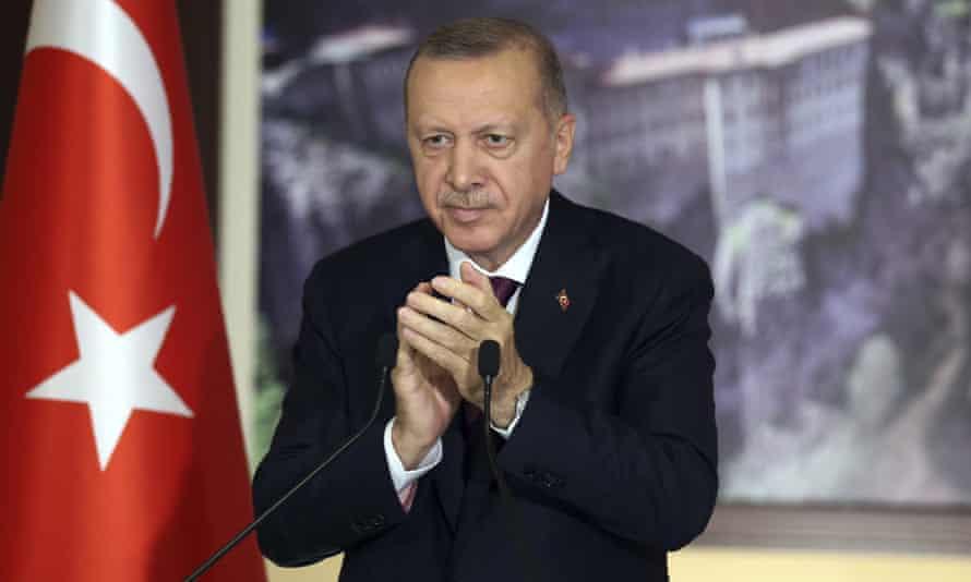 Turkey's President Recep Tayyip Erdoğan applauds lawmakers in Istanbul in July before voting on the social media bill.