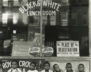Children sitting in front of restaurant window, Chicago, 1950