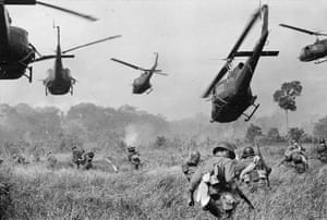 Hovering US Army helicopters pour machine-gun fire into the tree line to cover the advance of South Vietnamese ground troops as they attack a Vietcong camp 18 miles north of Tay Ninh, near the Cambodian border, in March 1965