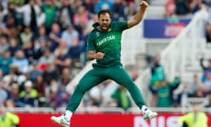 Wahab Riaz of Pakistan celebrates taking the wicket of Chris Woakes of England.
