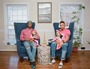 Vernon and Ricardo with their twin girls at home. Clinton, Maryland