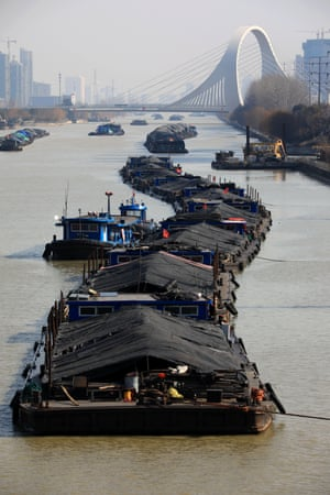 Ships carry coal along the Beijing-Hangzhou Grand Canal in Huai'an, China