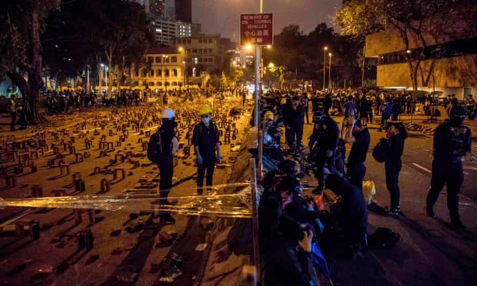 Protesters gather on a blocked road in Hong Kong