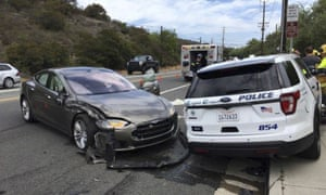 Photo provided by Laguna Beach police shows a Tesla sedan that crashed into a parked police cruiser on Tuesday.