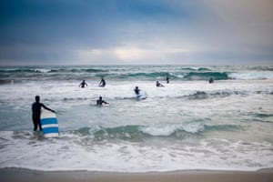 Novice surfers learn how to ride a wave in Unstad