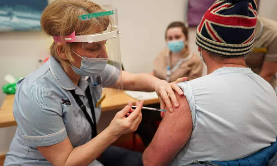 A key worker from North Shields receives the Pfizer-BioNTech Covid-19 vaccine in Newcastle upon Tyne, northeast England, on 9 January.