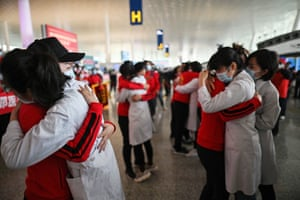 Medical staff from Jilin Province (in red) hug nurses from Wuhan