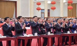 Xi Jinping (third left) and party leaders attend a lunar new year reception. State media has downplayed the coronavirus outbreak, despite 25 deaths in China.