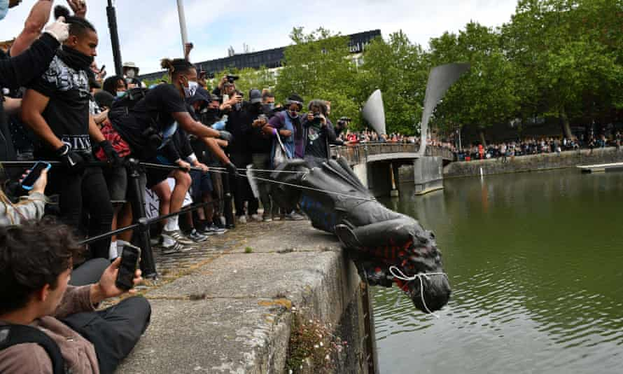 Protesters throwing a statue of Edward Colston into Bristol harbour, June 2020
