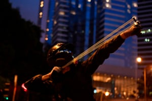 A protester uses a slingshot in Causeway Bay, in Hong Kong on August 31, 2019.