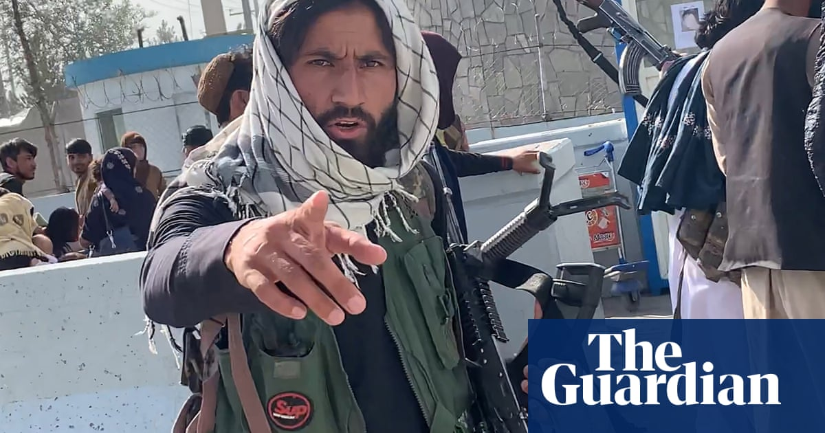 Taliban seek to assert control around Kabul airport as death toll rises to 20