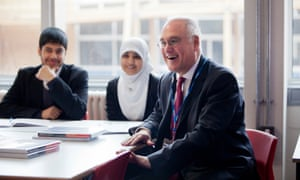 Former Ofsted chief inspector Sir Michael Wilshaw with pupils at a school in Birmingham in 2012.