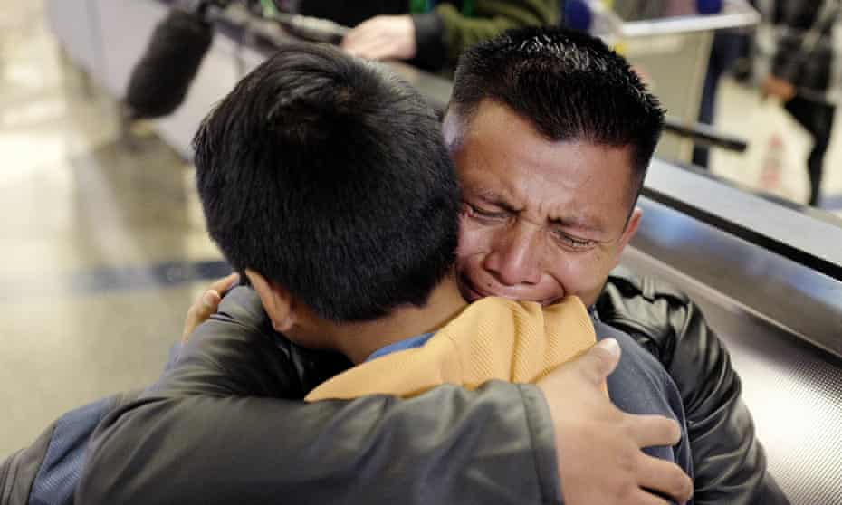 David Xol-Cholom, of Guatemala, hugs his son Byron at Los Angeles international airport as they reunite after being separated by the Trump administration.