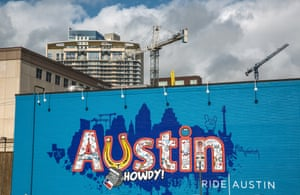A colorful downtown wall mural sits in the shadow of new highrise construction in Austin, Texas.