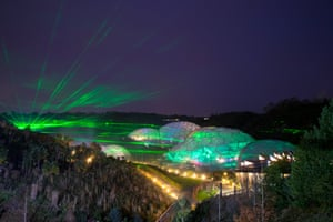 St. Austell, UK. Lasers from a light and sound festival illuminate the Biomes at The Eden Project in Cornwall