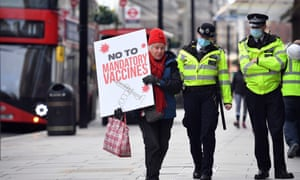 A protestor attending an anti-vaccine demonstration outside the offices of the Bill and Melinda Gates foundation in central London today. (There is no government plan to make vaccination mandatory.)