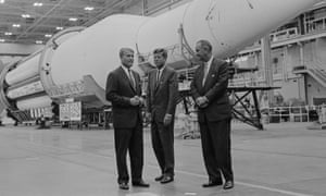 Rocket men: President Kennedy and Vice President Johnson at the George Marshall Space Flight Center with giant Saturn G-1 rocket.
