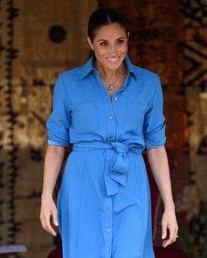 HRH Megan Markle has worn this same blue dress by Veronica Beard on multiple overseas visits.