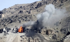 An explosion following an airstrike by Saudi-led forces targeting a suspected arms depot on a mountain overlooking Sana'a on Thursday