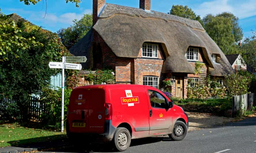 Royal Mail van parked in front of thatched cottage in Berkshire, England
