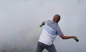 Man prepares to throw a bottle