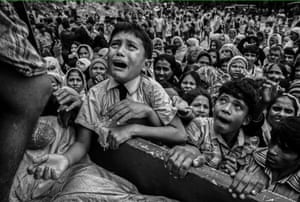 A Rohingyan refugee boy pleads for aid at the Balukali refugee camp in Bangladesh in 2017. Photograph: Kevin Frayer/Getty Images