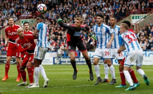 Huddersfield Town's Jonas Lossl punches the ball clear during the 1-0 win for Town against Watford at the John Smith's Stadium.
