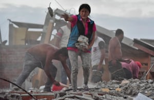 Ecuadorean Veronica Paladines, removes rubble in search for her husband at Tarqui neigbourhood in Manta