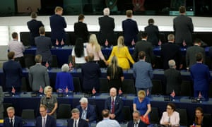 Brexit party MEPs turn their backs to the assembly as the European anthem is played during the first session of the new European parliament.