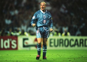 England's Paul Gascoigne urges his team mates on after scoring his penalty kick.