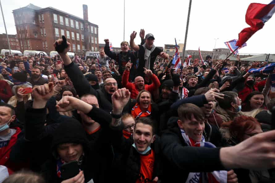 Rangers fans celebrate outside the ground.