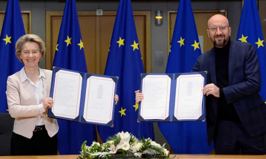 Ursula von der Leyen and Charles Michel show the signed Brexit trade agreement.