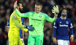 Jordan Pickford apologises to the Everton supporters after allowing a looping ball to bounce off the crossbar and into the path of Divock Origi.