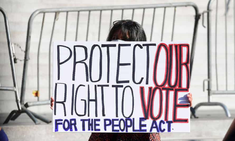 Voting rights activists rally outside Los Angeles' city hall on 7 July.