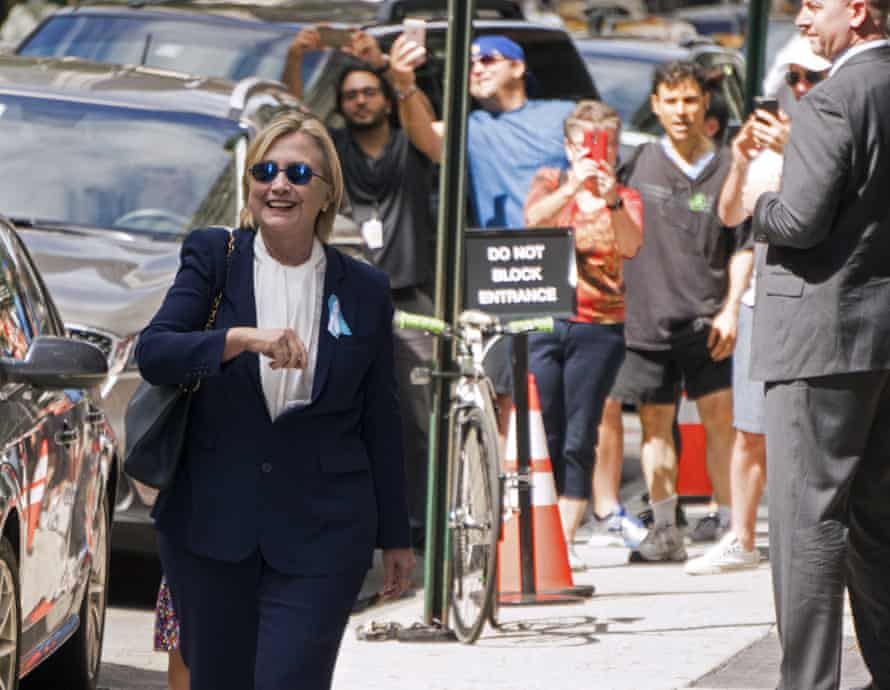 Hillary Clinton walks from from her daughter's apartment building Sunday, Sept. 11, 2016, in New York