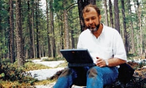 Andrew Veitch writing a script on a mountain near Lake Baikal, Siberia, in 1992