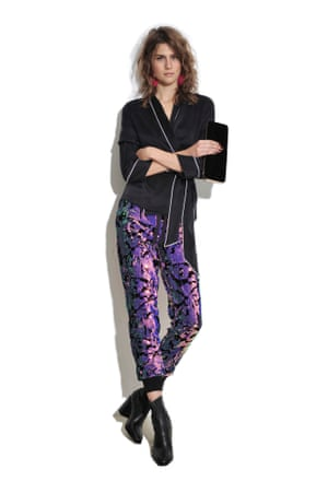 PYJAMA PARTY Make it an evening look by teaming with sequin trousers. Sequin jogging pants £65, topshop.com Boots £165, and clutch bag £55, both stories.com Earrings £6.99 hm.com Pyjama top (part of set) as before