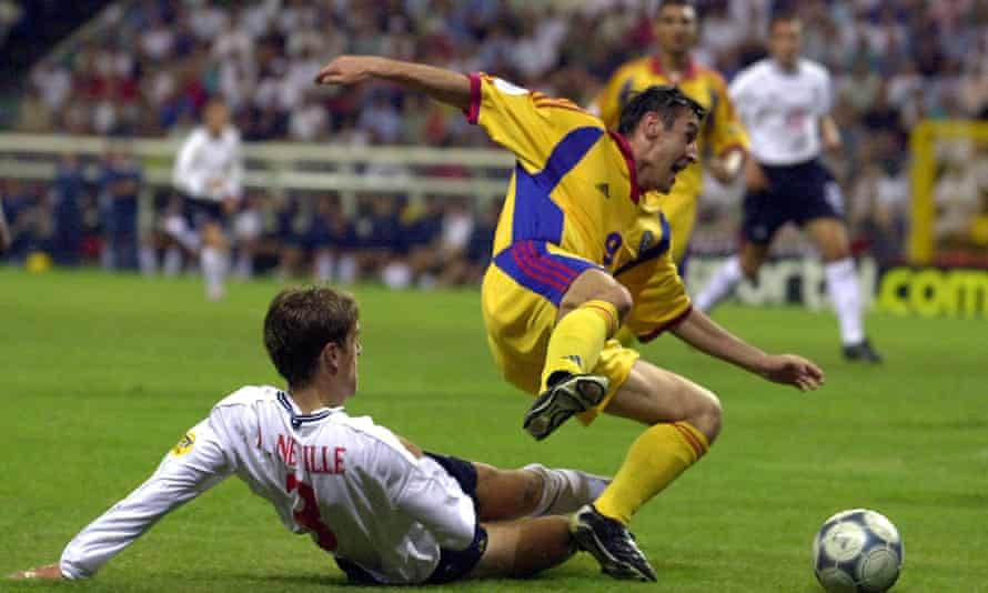Phil Neville brings down Viorel Moldovan to concede a penalty at Euro 2000.