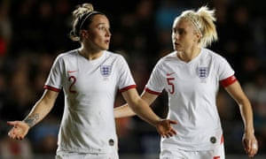 England's Lucy Bronze and Steph Houghton, right, wear the specially designed kit against Canada.