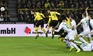 Dortmund's Paco Alcácer, left, heads the opening goa against Werder Bremen.