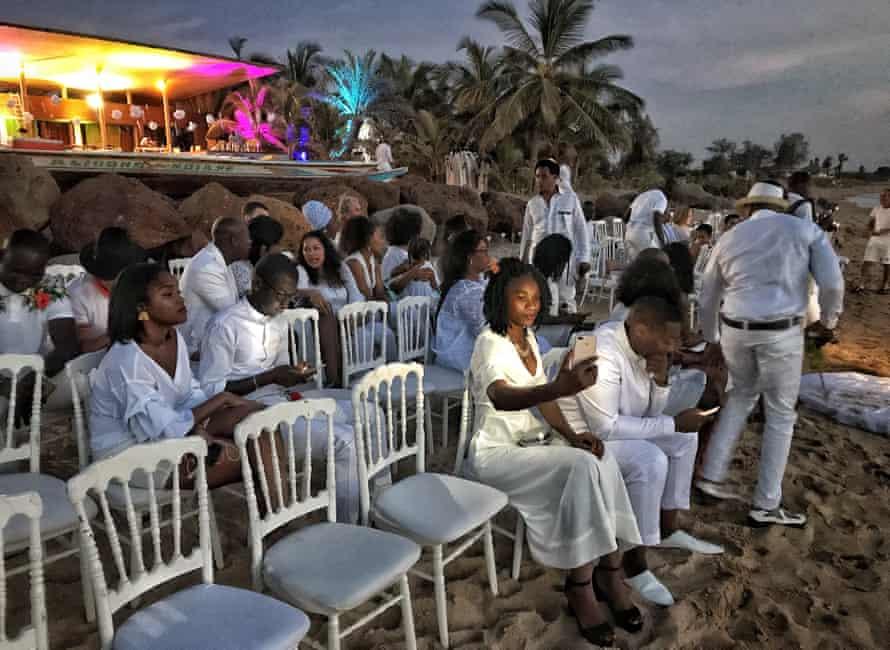 Guests attend a beach wedding near Dakar, November 2018