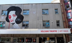 Exterior view of mural on wall of Volcano Theatre Art Haus on Wind Street in the city of Swansea