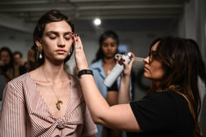 A model prepares backstage ahead of the ANNA QUAN show.
