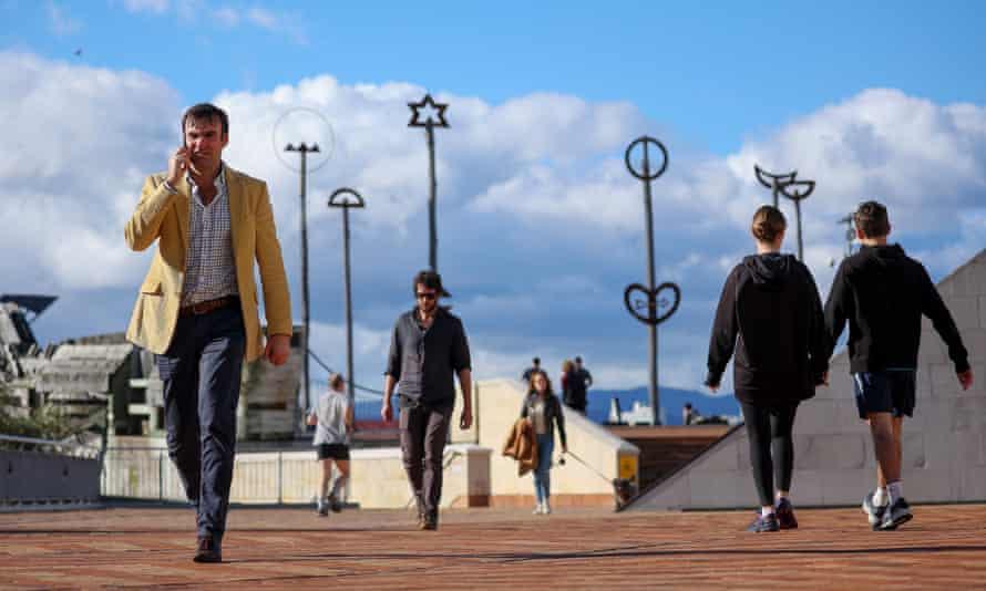Pedestrians walk along the waterfront in Wellington, New Zealand during its recent move to alert level 2. Masks were no mandated under the restrictions.